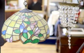 An Edwardian gilt metal and crystal drop bag chandelier and a Tiffany style lamp