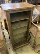 An oak and pine glazed music cabinet, glass fronted door with key, six shelves, width 52cm, depth