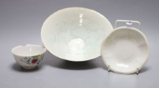 An 18th century Chinese famille rose tea bowl, together with a Qingbai type bowl and dish, largest