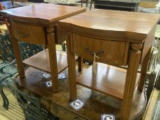 A pair of walnut bowfront two tier bedside tables, width 50cm, depth 50cm, height 61cm