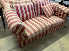 A pair of modern Chesterfied settees with red and cream upholstery (upholstery worn), length