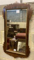 A George III style mahogany fret cut wall mirror, width 42cm, height 80cm