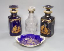 A pair of Limoges scent flasks, a silver mounted glass decanter and a Coalport dish, tallest 23cm