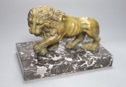 A 19th century bronze of a lion on a marble base, length 19cm