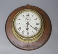 Kenneth James White Ltd., Glasgow and London. A brass cased bulkhead timepiece, mahogany mounted
