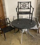 A painted aluminium circular garden table, 106cm diameter together with four matching elbow chairs