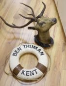 A taxidermic stag's head with antlers (a.f.) and a vintage life saving ring (2)