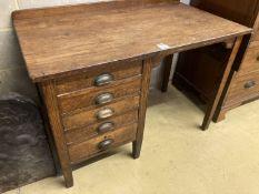 An early 20th century oak five drawer drop flap kneehole desk, width 108cm, depth 60cm, height 78cm