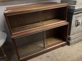 A pair of Minty style teak two section bookcases, width 89cm depth 29cm height 76cm