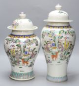 Two Chinese famille rose vases and covers, tallest 47cm