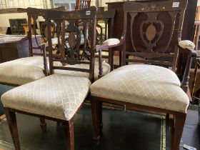 A pair of Edwardian inlaid mahogany elbow chairs and two matching single chairs