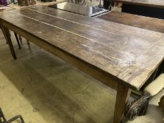 An early 19th century French oak rectangular kitchen table, length 218cm, depth 79cm, height 77cm