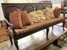 A George III panelled oak settle with rush and squab cushion seat, width 184cm, depth 56cm, height