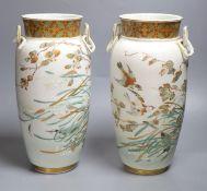 A pair of rare Japanese ceramic vases, signed Tokyo Houen, Meiji period, height 33cm