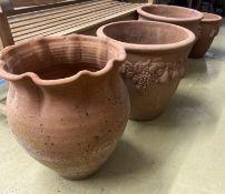 Four circular terracotta garden urns, largest 50cm diameter, 46cm high