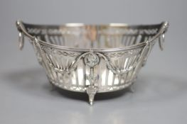 A late 19th/early 20th century Dutch pierced white metal ring handled navette shaped bonbon