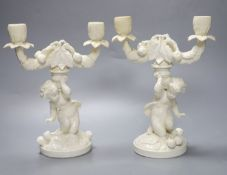 A pair of English bone china 'cherub' candelabra, possibly Moore Bros., height 26cm