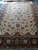 A Heriz ivory ground carpet, 326 x 237cm