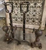 A pair of Victorian wrought iron fire dogs, together with one other pair of brass mounted fire dogs,