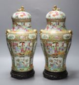 A pair of 19th century Cantonese vases and covers, with later stands, overall height 44cm (a.f.)