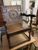 An 18th century style oak wainscot type elbow chair, width 58cm, depth 45cm, height 89cm