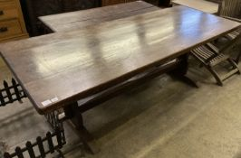 An 18th century style rectangular refectory dining table on trestle end supports, length 212cm,