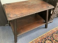 A rectangular carved hardwood two tier table, width 90cm, depth 56cm, height 64cm