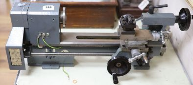 Clockmakers tools - a grey painted lathe with stud gear box, no maker's mark, 71.5cm long