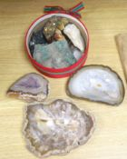 An amethyst geode section and assorted mineral specimens
