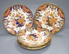 A set of six Royal Crown Derby dessert dishes, decorated in an Imari palette, diameter 23cm