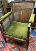 A Regency mahogany bergere armchair, width 67cm, depth 64cm, height 92cm