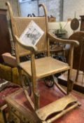 An early 20th century 'Wardway' caned beech invalid's chair, width 50cm, depth 80cm, height 118cm
