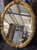 A Victorian style oval gilt framed wall mirror, width 75cm, height 94cm