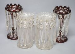 A pair of Victorian ruby overlaid table lustres and a pair of late Victorian clear glass table