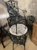 A Victorian style painted circular aluminium garden table, 68cm diameter together with a set of four