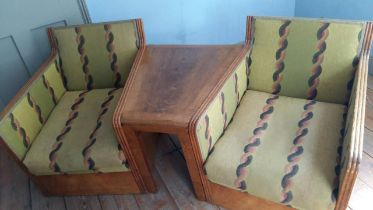 An Art Deco oak three section conversation seat, possibly with its original upholstery, width 170cm,