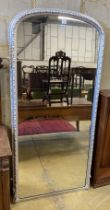 A Victorian, later silvered carved wood framed overmantel mirror, width 92cm, height 195cm