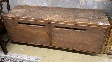 A Betty Joel style oak two door low cabinet, length 137cm, depth 44cm, height 55cm