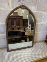 An oak lancet shaped framed wall mirror, (formerly from a dressing table) width 56cm, height 85cm