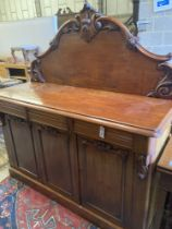 A Victorian carved mahogany sideboard fitted drawers and cupboard, length 150cm, depth 56cm,