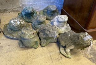Eight reconstituted stone garden ornaments of frogs and toads, three as fountain heads, largest 18cm
