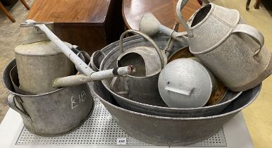Eight assorted galvanised tubs, feeders and watering cans, largest 80cm, width 56cm