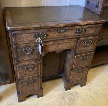 A Queen Anne style walnut kneehole desk, width 74cm, depth 44cm, height 77cm