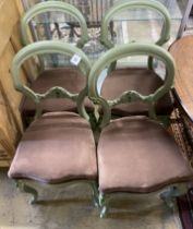 A set of four painted Victorian dining chairs and an oval centre table