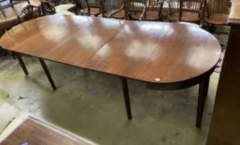 A George III mahogany 'D' end dining table, on square tapered legs, with three spare leaves, 274cm