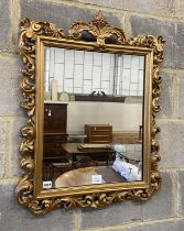 A Florentine style gilt carved wood wall mirror, width 58cm, height 76cm