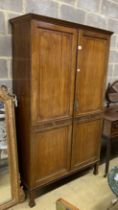 A Dutch style mahogany wardrobe, with double full length panelled doors, on square tapering legs