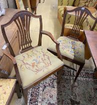 A set of six Hepplewhite style mahogany shield back dining chairs with tapestry drop in seats (two