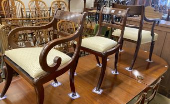 A set of eight Regency mahogany brass inlaid dining chairs, on sabre legs and a similar elbow chair