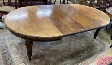 A late Victorian oak extending dining table with two leaves, 270cm extended, width 138cm, height
